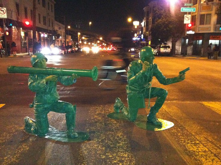 Couple dressed as classic Army guy toys (radio man and bazooka girl).