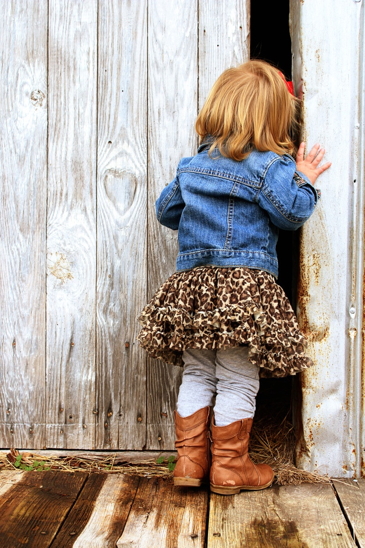 I love so much about this pic..leopard print, lil cowgirl boots, Jean jacket, and Old shed door <3