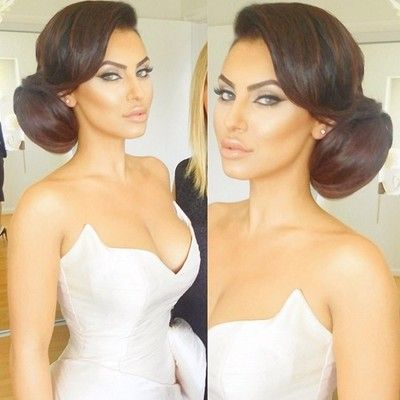 Bun is a little big but love this classic beauty style - especially the fringe