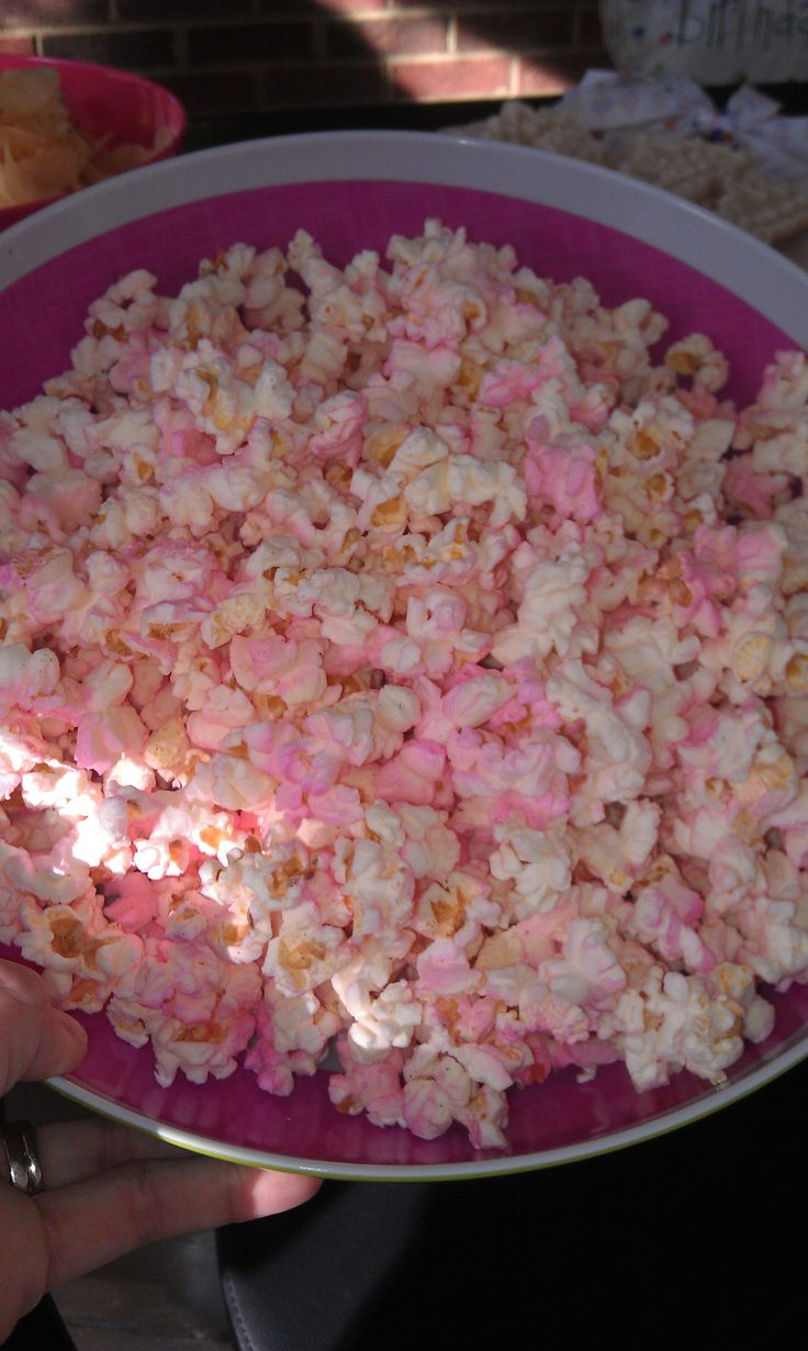 Princess Popcorn!    ~Simply pop a bag of popcorn and spray it with any color food coloring spray!  I used Wilton pink food coloring spray.  I found it at Party City.  It was a hit at my daughter's 3rd Birthday party!