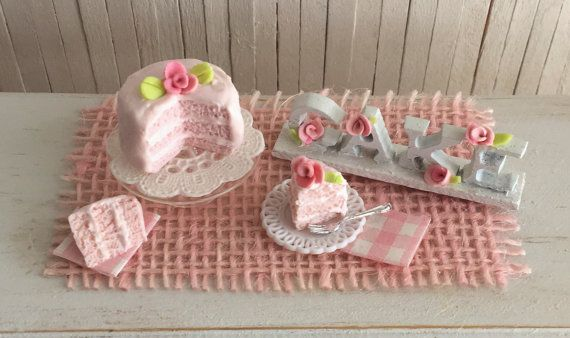 Miniature Pink Layer Cake With A Rose, A Glass Cake Stand, A Slice
