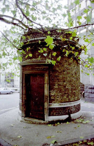 """The entrance to the Tower Subway - the first 'tube' line in the world. It ran under the Thames but was only open for a few months.    This is its north side of the river entrance on Tower Hill, rebuilt after closure. According to Mark Brader, the equivalent south side entrance """"...fell to redevelopment"""" in the 1990s."""