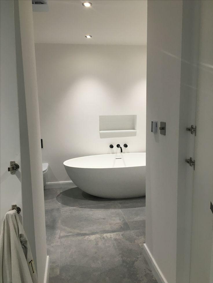This minimal ensuite bathroom was 'hidden away' behind the cupboard doors