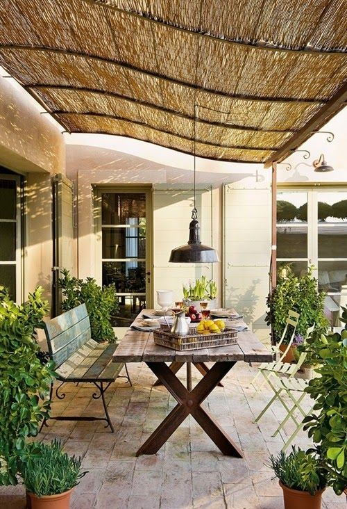 Belgian Pearls:  Southern accents.  I like this patio covering--the curve of the rods and the straw matting.
