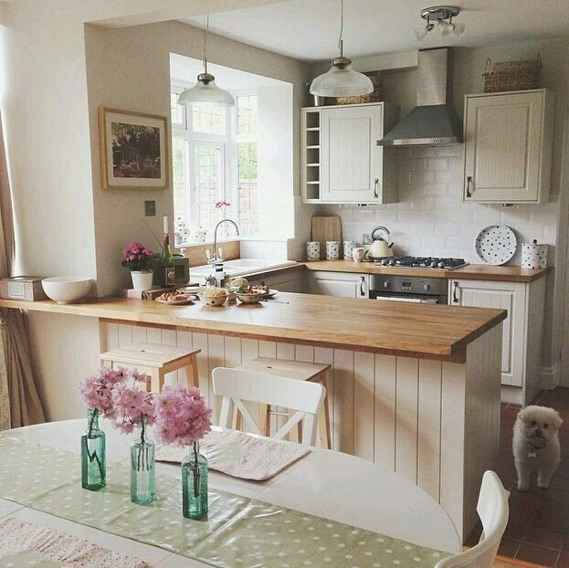 Fabulous bay shaped window in the small kitchen ..... really like this