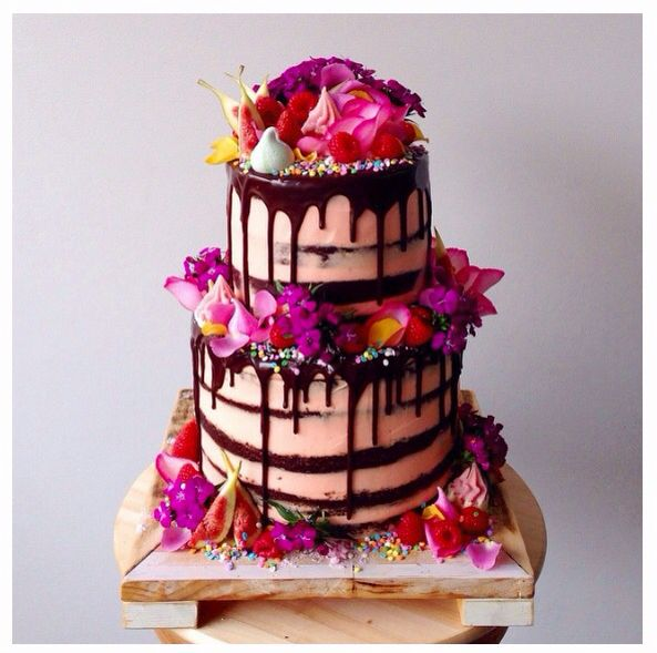 Beautiful candy and tropical flowers wedding cake.