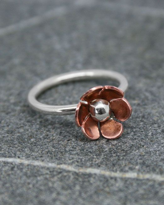 A delightful handmade copper and silver daisy ring with a 10mm copper flower and silver bead in the centre set on a simple silver wire band.  Also available with brass petals.  #copper #daisy #flower #handmade #ring #silver #starboardjewellery #jewellery #cornwall #uk #gb #westcountry #devon #england #silversmith #pretty #jeweller #jewellers #handmadejewellery #jewellery #cornwall #uk #gb #westcountry #devon #england #silversmith #pretty #jeweller #jewellers #handmadejewellery