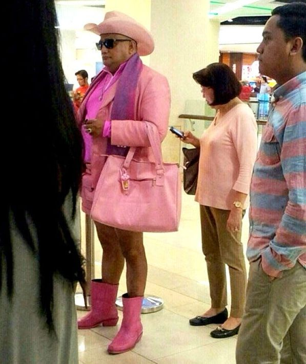 Big Strong Macho Man Dressed in Pink - Boots, Pocketbook, Jacket, and Hat!!! ---- funny pictures hilarious jokes meme humor walmart fails