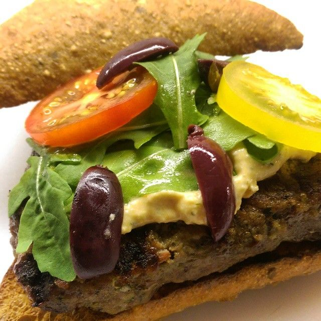 TGIF! Lamb burgers with a feta, sundried tomato and dill spread... Bring on spring (please). #olives #tomatoes #arugula @zimmysnook