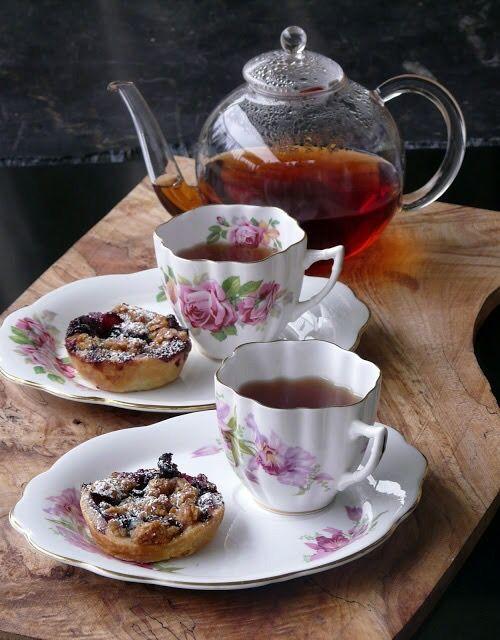 Afternoon tea with scones served on tea platters.