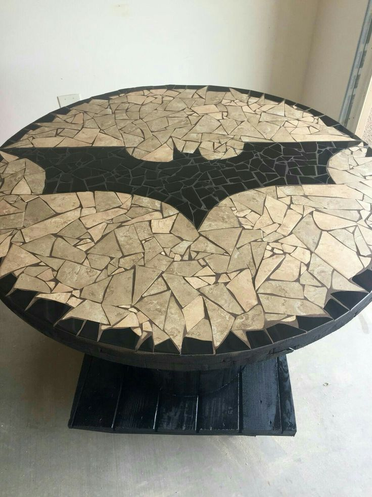 A very cool looking circle batman table can be used up to - Cool things to buy for your room ...