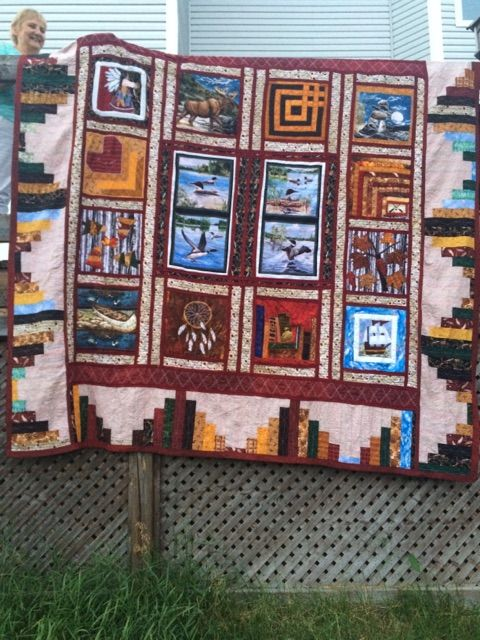 Quilt depicting Anne and Doug's life together.