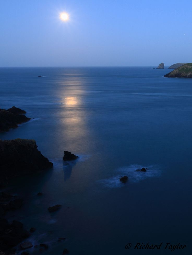 Moon setting over the Atlantic near Skomer Island, Pembrokeshire.
