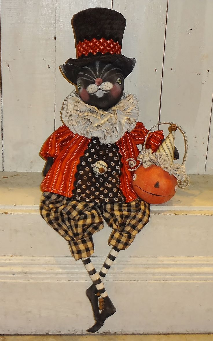 Halloween Cat doll with Jack O lantern.   The Pixie's Thimble by Cindy Conrad