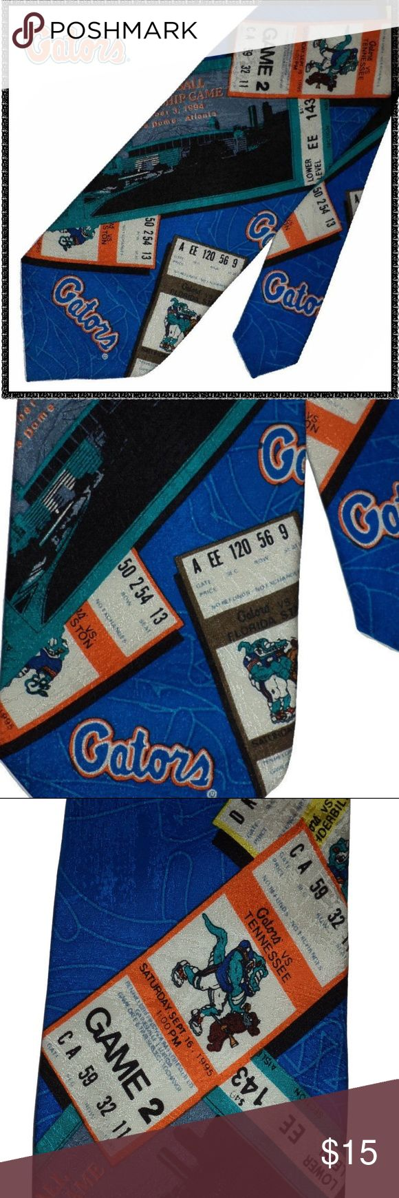 """UF GATORS Tie VINTAGE Orange & Blue FLORIDA Silk A vintage 1995 University of Florida GATORS necktie. VERY gently previously owned.  The it is in excellent condition.  NO rips, stains or snags. 100% Silk, it shows admittance tickets to various games and the SEC championship game in 1995. It measures about  57"""" long & 4"""" wide. Made in the U.S.A.  Eat 'em up GATORS eat 'em up ~ CHOMP CHOMP!! #5293 We R Ties Accessories Ties"""