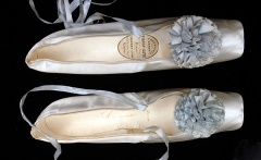 Women's Evening Shoes  c.1862  Pale blue satin with matching ribbon pompon Belonged to Empress Eugene. Size: Length: 22.5 cm; Greatest width: 5 cm