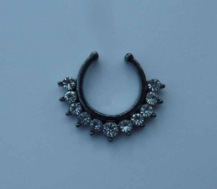 This is a black (dark gray) titanium clear crystal fake septum ring. It will ship the next business day after it is ordered. Please message me with any questions. Like my Facebook page! www.facebook.c