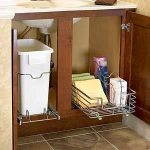 Simple storage solution.  For similar trash caddy's visit our website! http://hideawayironingboards.com/products/easy-pull-single-trash-slide