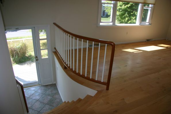Widened and curved Stairs in a raised ranch entryway