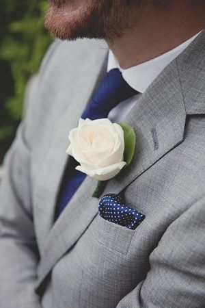 Love the blue accessories - Grey will compliment most wedding colour schemes