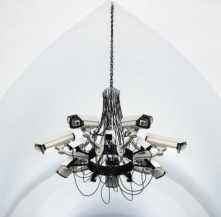 """Addie Wagenknecht, """"Asymmetric Love"""", 2013. """"Asymmetric Love was intended to mimic an iconic baroque chandelier. It attempts to be perceived as something familiar in memory by the audience so that the details of the CCTV cameras recording them is overlooked. In that regard the surveillance is not perceived as a direct threat, which becomes the biggest threat of all."""""""