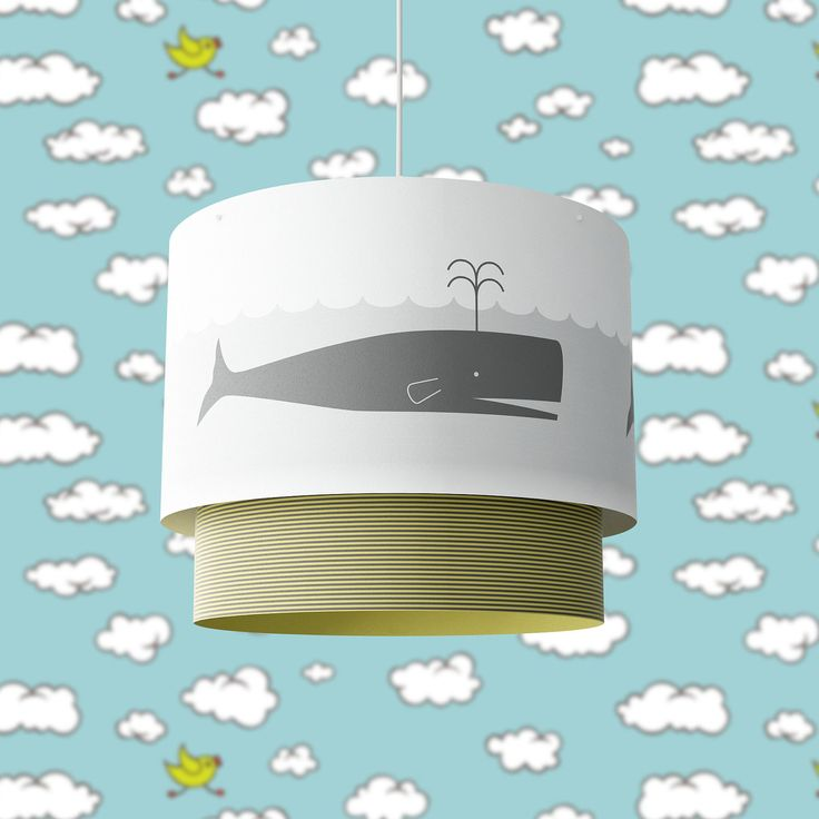 An adorable paper lamp decorated with a spouting whale would be right at home in a child's room.