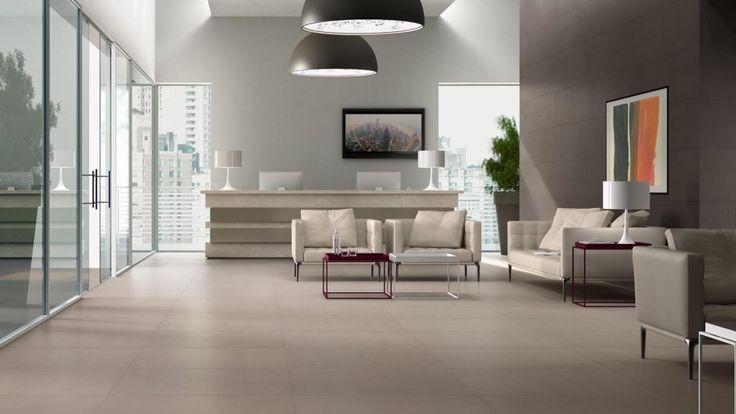 Fliesen im Betonlook erobern moderne Wohnbereiche an Wand und Boden.