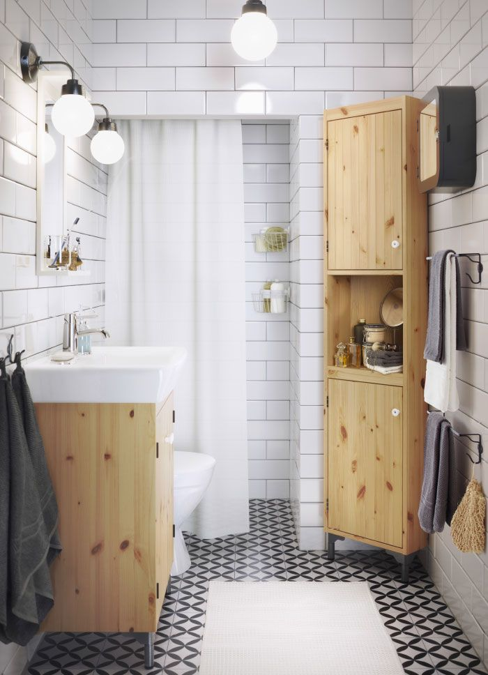 A small white bathroom with sink cabinet and tall corner cabinet in solid pine.