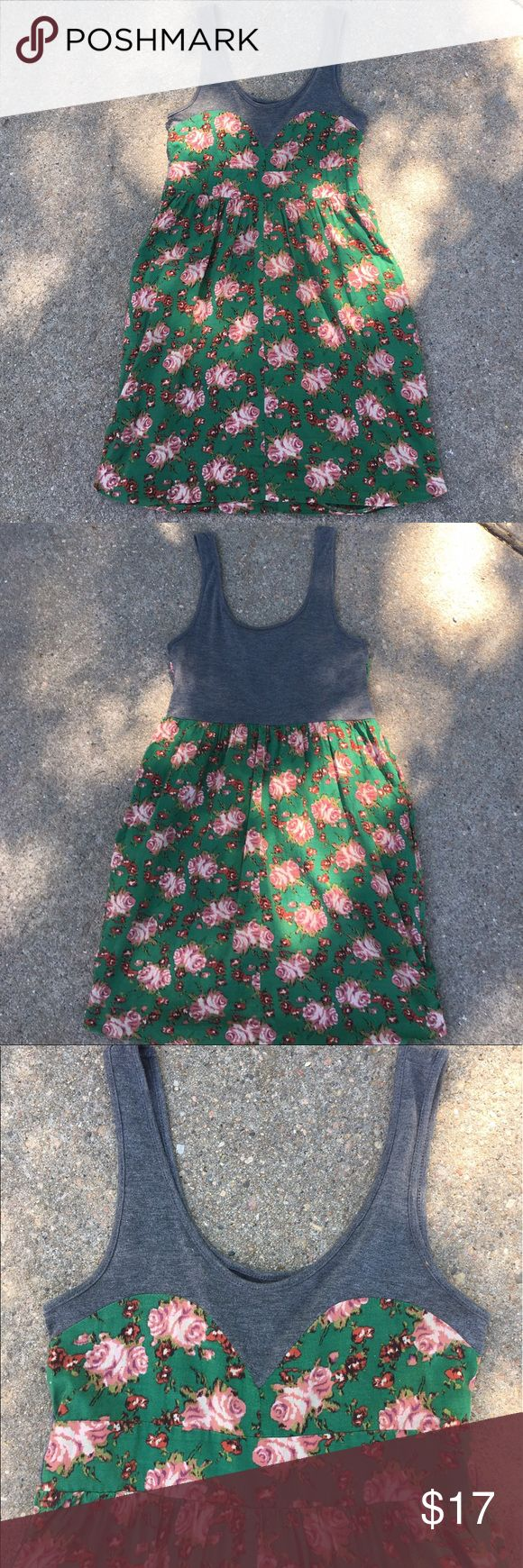 "Super Cute Dress with Flowers Urban Behavior tank dress-the top is dark gray-bottom is green with different colored pink-ish flowers-has pockets😊-approx. 28"" wide in the chest area but does stretch a bit- length is approx. 32"".                                                                 🚭Smoke Free Home Urban Behavior  Dresses Mini"