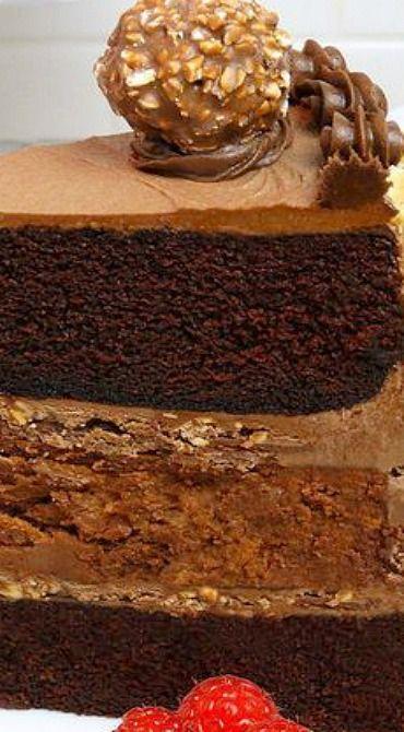Chocolate Nutella Cheesecake Cake ~ Moist Chocolate Hazelnut Velvet Layer Cake with creamy and flavorful Nutella Cheesecake, crushed Ferrero Rocher® Hazelnut Chocolates for added crunch and sublime Chocolate-Nutella Cream Cheese Buttercream. Irresistible! Everyone will love this cake! | chocolate hazelnut dessert recipe