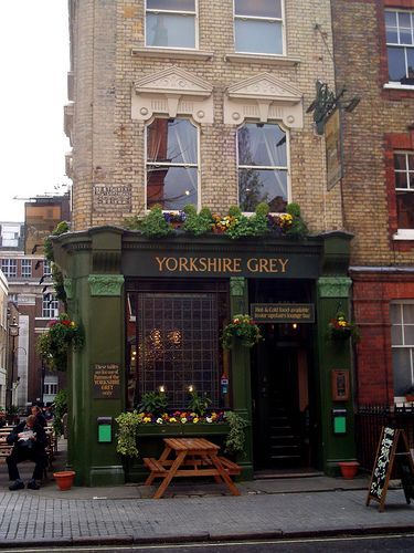 exterior - green with black and gold letters. Window boxes. Yorkshire Grey pub