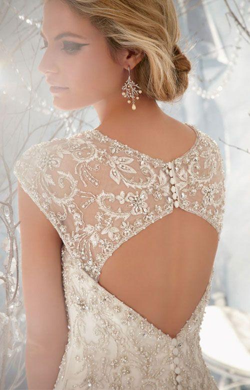 Finely detailed lace cutout back #weddingdress - Plan your wedding the smart way at www.myweddingconcierge.com.au
