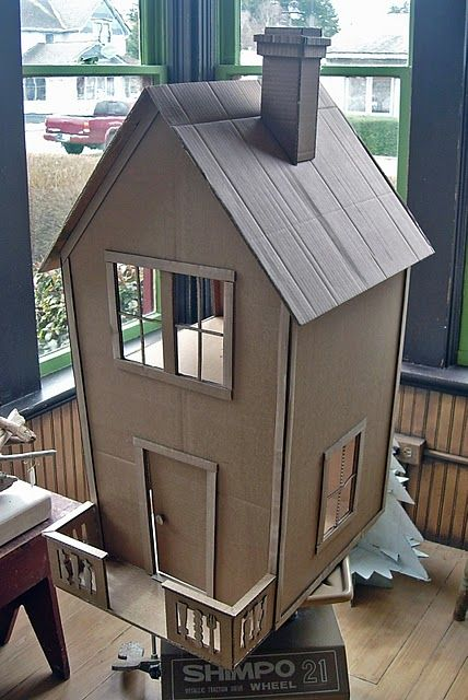 cardboard house  Made of Cardboard but COULD be made with thin board!