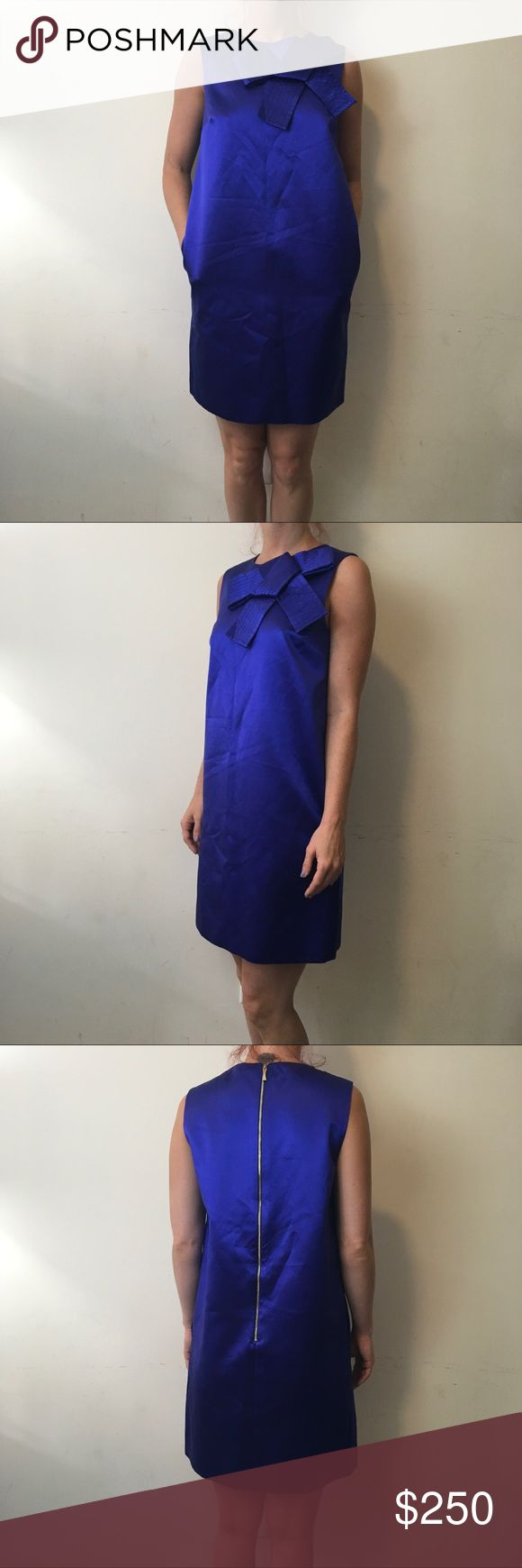 Madison Ave Kate Spade Bow Blue Silk Satin Dress Madison Ave Kate Spade dress with a sleeveless body and zipped closure. Satin silk and is a vibrant color of blue! Very rare and hard to find don't miss this gorgeous dress!!! Unique and perfect for weddings or special occasions! 🎀🎀🎀🎀 kate spade Dresses