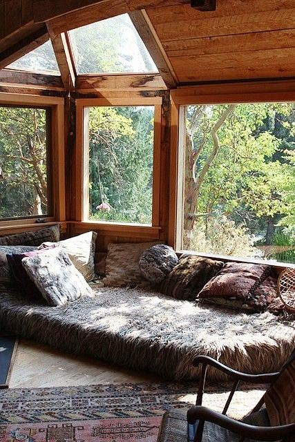 Love the bed style seating right by the window. | 53 Stunning Ideas Of Bright Sunrooms Designs.