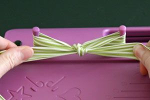 Another perfect bow tutorial - great photo tutorial and video as well.