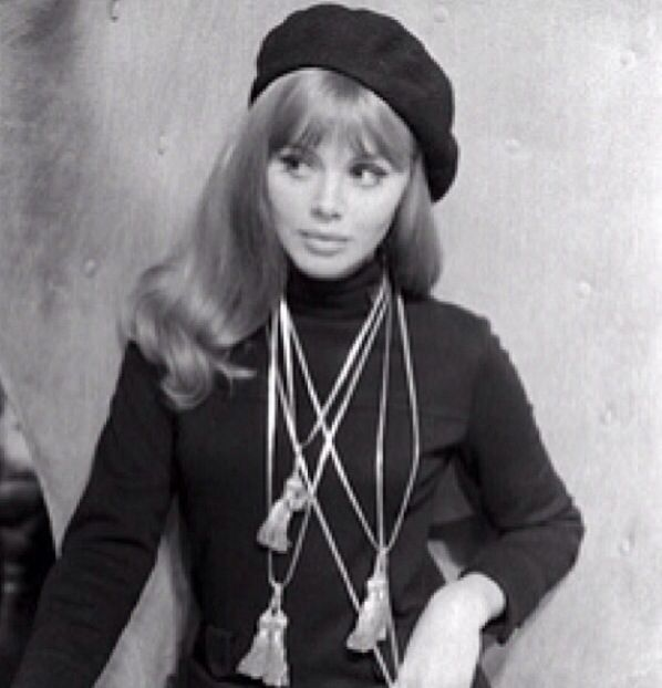 """1960s beatnik. Beatniks were characterized by """"beards, pony tails, dirty sneakers, and peasant blouses."""" They often wore all black."""