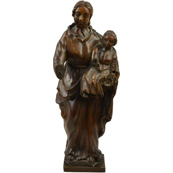 An oak naive carving of the Madonna and Child, probably once part of a larger group.  French, 17th century circa 1660