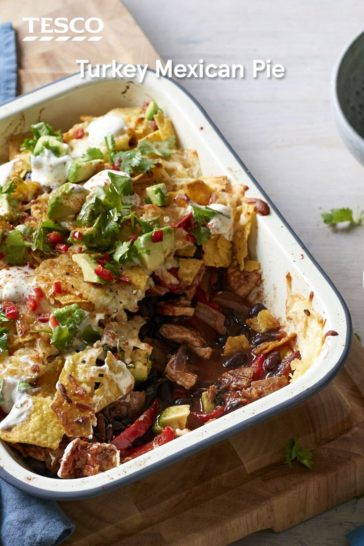 Give your turkey leftovers a spicy makeover with this Mexican turkey pie recipe. The whole family will love these upside-down nachos, with a quick and easy turkey chilli base and crunchy, cheesy tortilla topping. | Tesco