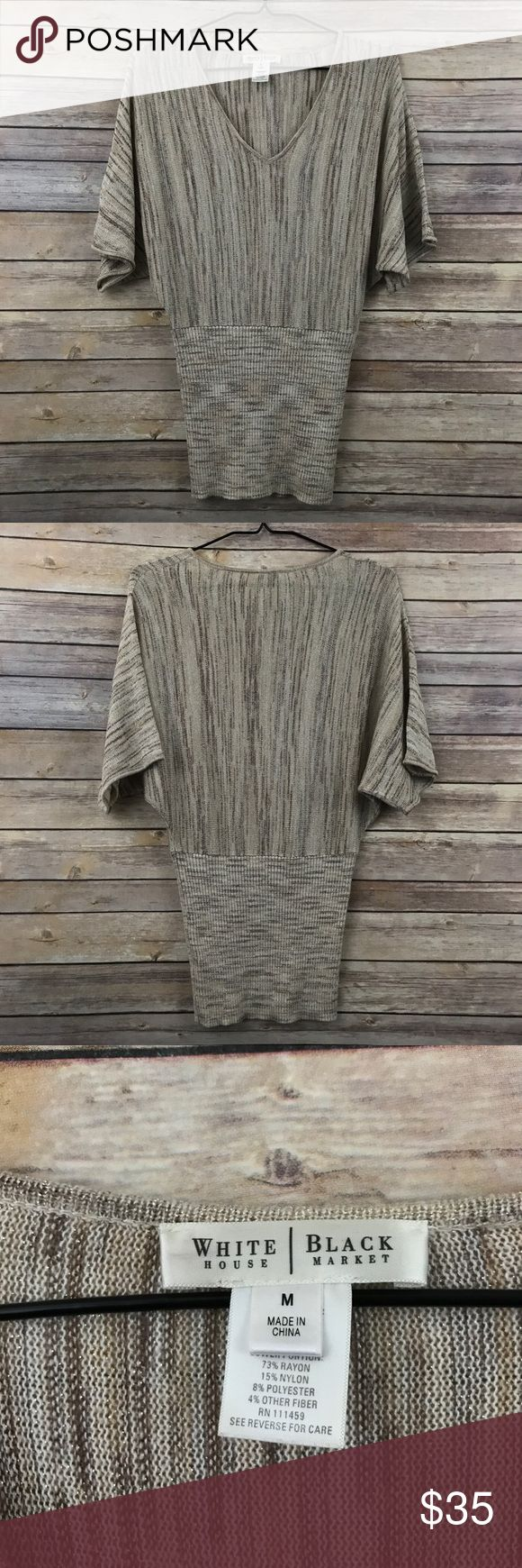 """WHBM Short Sleeve dolman sweater tan gold Sz M 459 This White House Black Market short sleeve dolman sleeve sweater has a banded bottom and is a tan, cream and gold metallic stripe/marled look sweater in a women's size Medium. It measures 16""""-18"""" flat across the bust unstretched and is 28"""" long. In good preowned condition with no known flaws and light overall wear. White House Black Market Sweaters V-Necks"""