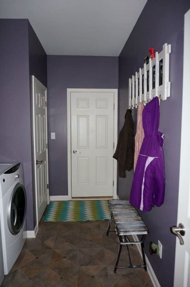 Laundry room after - Painted walls Sherwin William's Exclusive Plum. Painted the coat rack in Sherwin William's Revere Pewter. Minus ugly rug