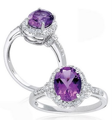 Purple Diamond Rings - I don't care that it's diamonds, they are retardedly overpriced and useless, as long as it doesn't turn my fingers green I'm all good! But....purple!