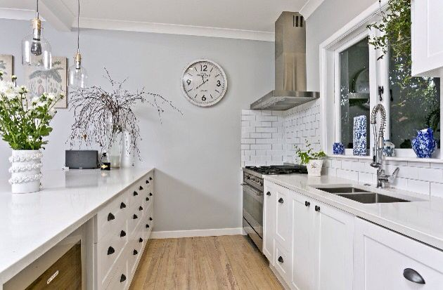 Butchers tiles for the gas oven splash back. White cabinetry finished in classic style with pull Cup cabinetry handles.