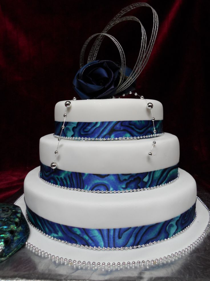 Maori /Paua themed Wedding cake. A true Kiwiana wedding cake. Celebrate your nation's identity with this special Paua shell themed wedding cake. www.frescofoods.co.nz email: fresco@woosh.co.nz