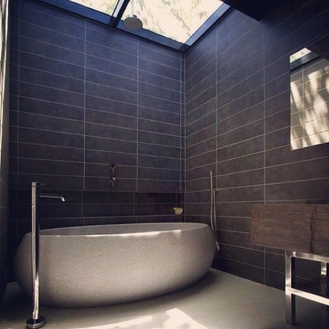 The positioning of this skylight brings so much warmth to this bathroom. In perfect synergy with the organic natural stone of this apaiser lotus freestanding bath. #apaiser #bath #stonebath #reclaimedmarble #freestandingbath #modernbathroom #bathroom #bathroomdesign #interiordesign #architects @architectseat photo courtesy of @deluxe_bts