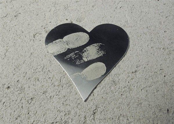 Custom Silver Fingerprint Heart token by Slashpile Designs