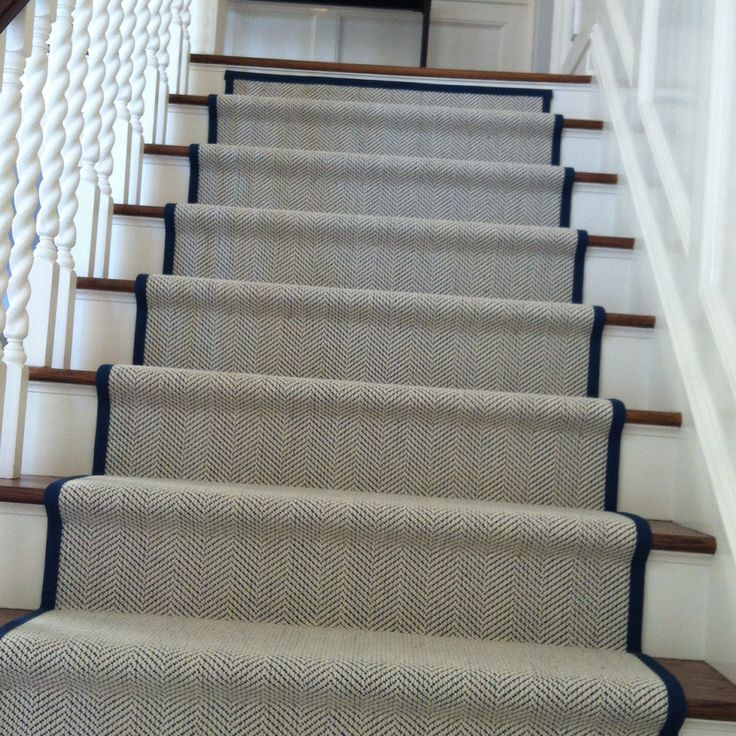 My new staircase runner. Herringbone with a marine blue binding.