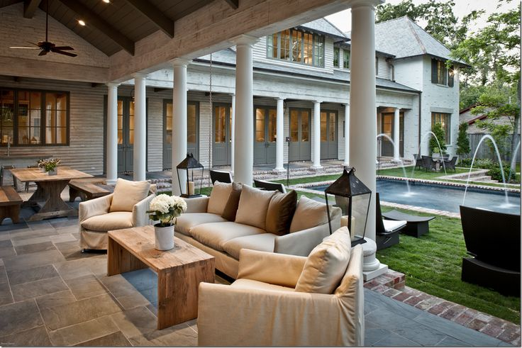 This entire blog couldn't be any better of an example of the exterior remodel of our home. We are doing white columns, slate and gray flooring/pavers and lining with brick accents. I can't wait!!!