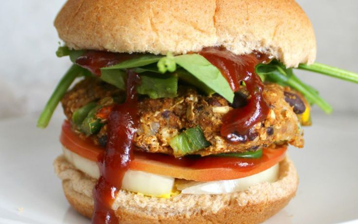 <p>Each patty is packed with beans, onions, and garlic, plus spicy brown mustard, Sriracha, and jalapeños.</p>