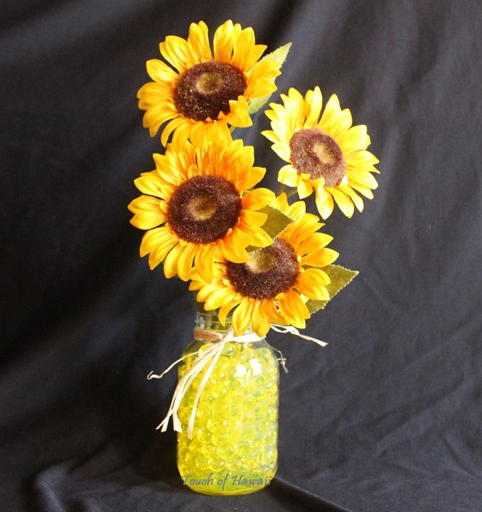 Sunflowers in a mason jar filled with #waterbeads will look great in any home or office!